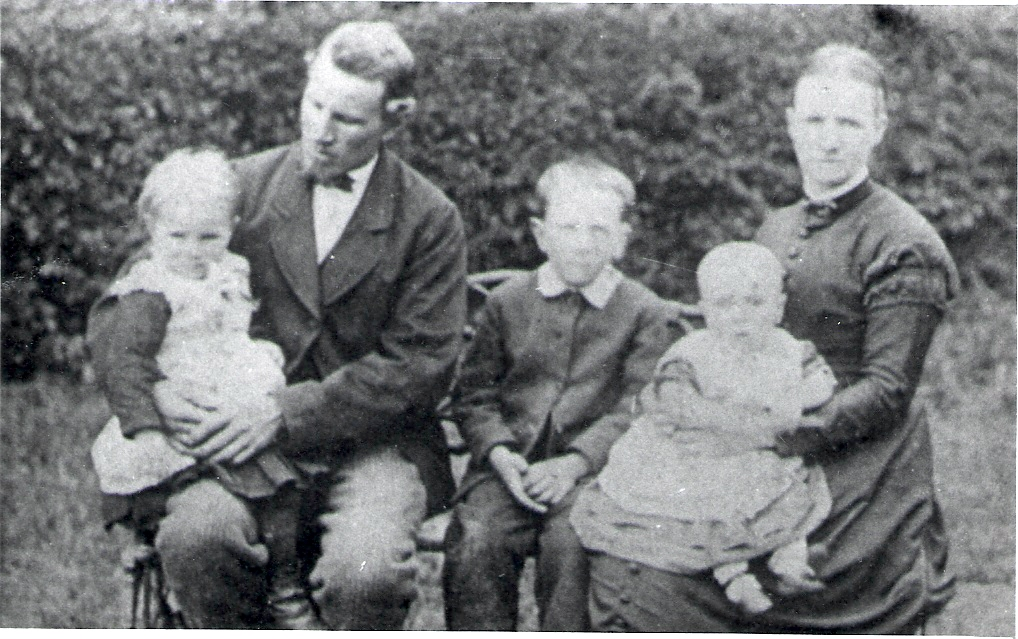 1885 at North Rode. Sarah or Alice, George, George-Tyson or James, Arthur, Elizabeth. John behind hedge struggling not to be included.