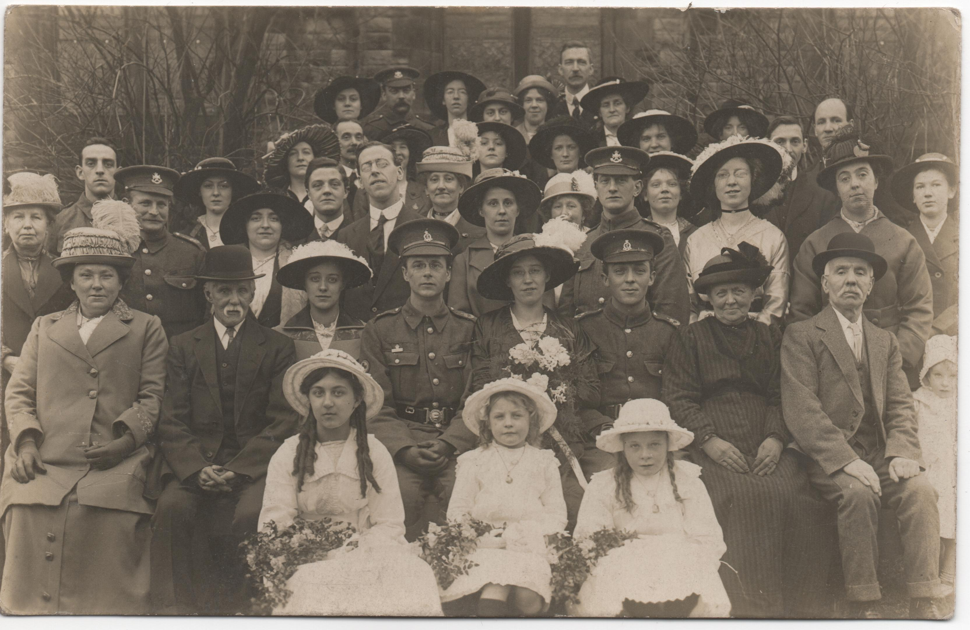 1914 wedding of Joseph Nall, Chapel en le Frith post office staff. William Hudson in back row
